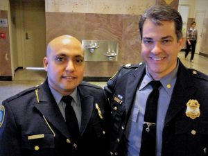 Officer Mohammed Tabiai (L) and Major Nick Elias of the SW Div