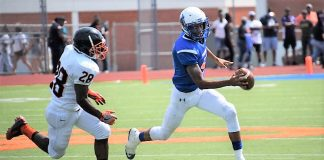 Millwood's Marcus Major runs past Douglass defender