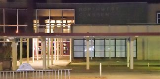 Northwest Classen High School at nite, walkout