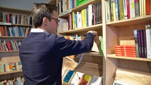 open, Ben Nockels shelves a book at the end of New Year's Day.